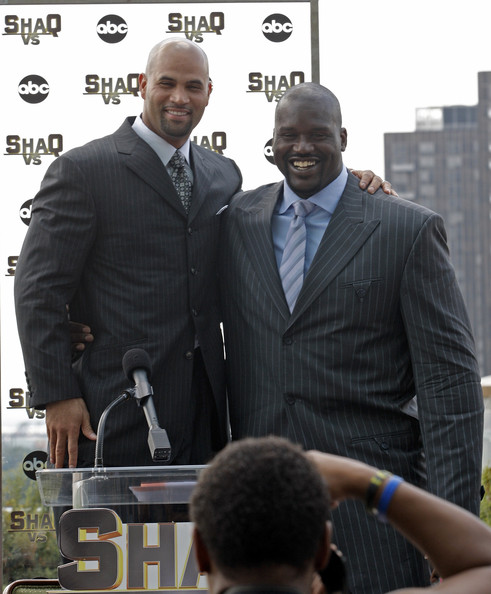 Albert Pujols looked sharp in a black pinstripe suit at a press conference.