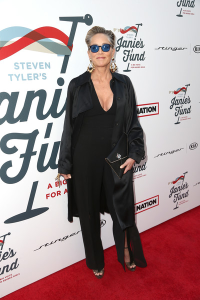 Sharon Stone Envelope Clutch [red carpet,eyewear,carpet,clothing,suit,premiere,flooring,outerwear,event,tuxedo,steven tyler,sharon stone,california,los angeles,live nation,inaugural janies fundgala grammy viewing party,red studios,gala benefitting janies fund]