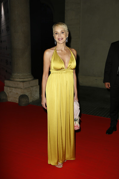 Sharon Stone Halter Dress [fashion model,dress,clothing,carpet,red carpet,yellow,fashion,shoulder,gown,hairstyle,ca del bosco,sharon stone,italy,rome,palazzo doria pamphilj]