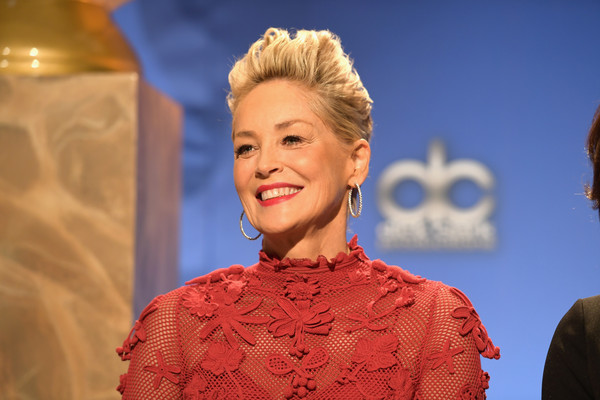 Sharon Stone Fauxhawk [hair,hairstyle,fashion,beauty,blond,bun,performance,event,dress,fashion design,los angeles,california,golden globe nominations announcement,sharon stone]