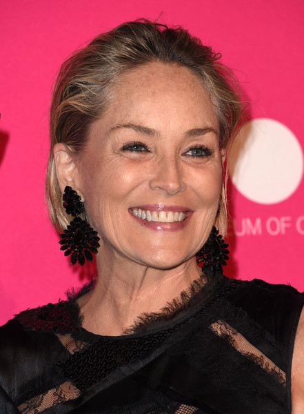 Sharon Stone Messy Cut [photo,hair,face,hairstyle,eyebrow,chin,smile,lip,premiere,ringlet,brown hair,sharon stone,chris delmas,museum of contemporary art los angeles,los angeles,geffen contemporary,gala,gala]