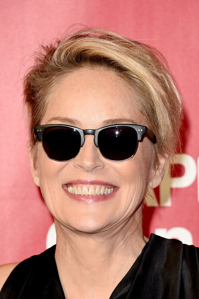 Sharon Stone Messy Cut [eyewear,sunglasses,hair,face,glasses,cool,hairstyle,eyebrow,chin,lip,musicares person of the year,los angeles,california,los angeles convention center,sharon stone,lionel richie - arrivals,lionel richie]