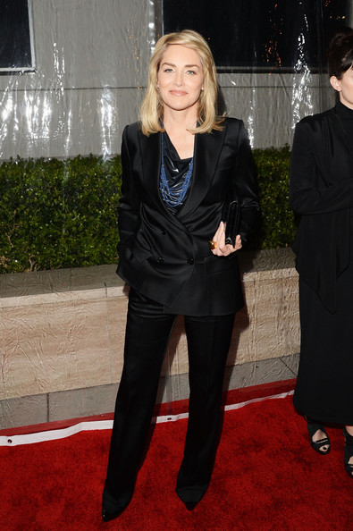 Sharon Stone Pantsuit [red carpet,clothing,red carpet,carpet,suit,flooring,outerwear,pantsuit,formal wear,tuxedo,leg,sharon stone,los angeles,california,milk studios,amfar inspiration gala]