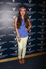 Danna Paola paired a purple top with neon pants for some added flair at the American Eagle Mexico City store opening.