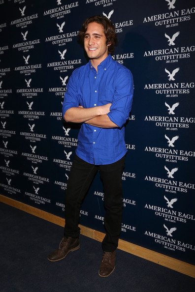 Diego Boneta looked classic and preppy in a blue button down shirt at the opening of American Eagle's Mexico City store.