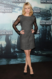 Rachel looked prim and proper in a sophisticated charcoal gray cocktail dress with sheer sleeves.