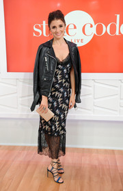 Shiri Appleby balanced out her sultry dress with an edgy leather jacket.