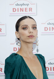 Angela Sarafyan looked elegant with her center-parted chignon at the Shopbop Diner.
