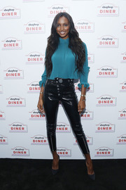 Jasmine Tookes gave her blouse a dose of edge with a pair of black leather skinnies by Alexander Wang.