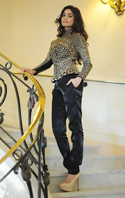 Puja Gupta topped off her cool and contemporary look with this pair of black shiny silk pants.