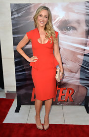 Julie Benz opted for a super structured red dress that featured peplum detailing at the waist and square shoulders.