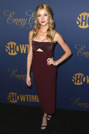 Katherine McNamara paired her dress with black ankle-strap sandals by YSL.
