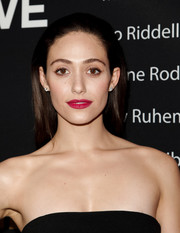 Emmy Rossum added a jolt of color with some bright berry lipstick.