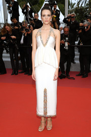 Stacy Martin teamed her dress with nude chain-embellished sandals.