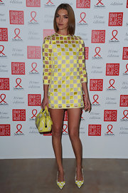 Arizona Muse got leggy in this playful checkered dress at the Sidaction Gala.