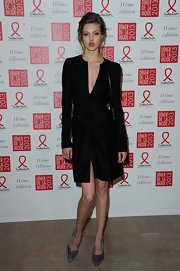 Lindsey Wixson looked simply flawless in this long-sleeve black dress at the Sidaction Gala Dinner.