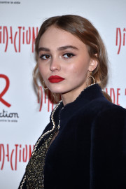Lily-Rose Depp chose an ultra-sexy matte red hue for her lips.