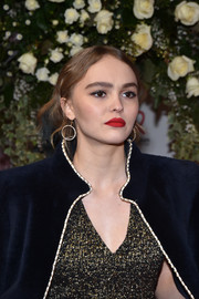 Lily-Rose Depp dolled up her lobes with a pair of diamond hoops for the Sidaction Gala 2017.