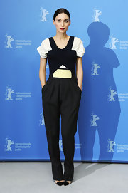 Rooney Mara teamed her trousers with a harness-like top.