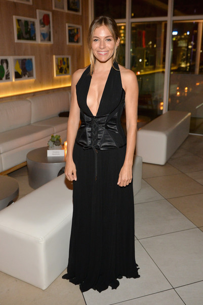 Sienna Miller Halter Dress [clothing,dress,shoulder,fashion,formal wear,little black dress,gown,cocktail dress,haute couture,event,kost,american woman,sienna miller,american woman premiere party,toronto,canada,premiere party]