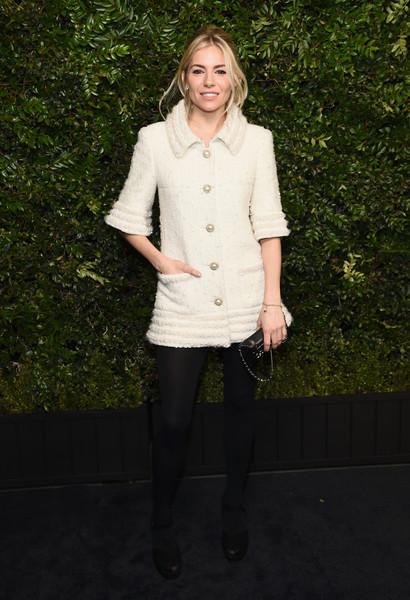 Sienna Miller Tweed Jacket [white,clothing,outerwear,fashion,standing,snapshot,footwear,jacket,tights,photography,charles finch,sienna miller,chanel pre-oscar awards,dinner,beverly hills,california,madeo,madeo in beverly hills,chanel]