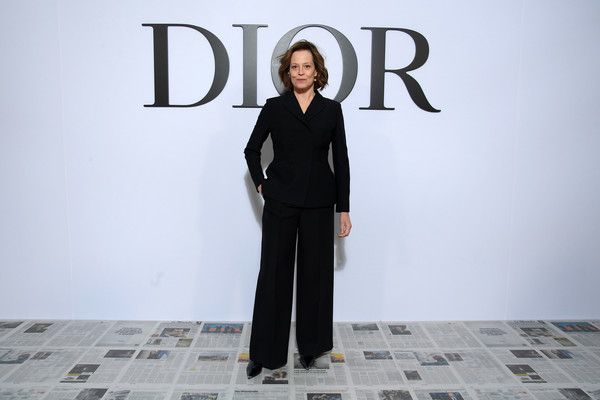 Sigourney Weaver Pantsuit [fashion,runway,design,fashion design,font,formal wear,outerwear,suit,photography,neck,sigourney weaver,part,paris,france,dior,paris fashion week womenswear fall,photocall - paris fashion week womenswear fall,fashion,business]