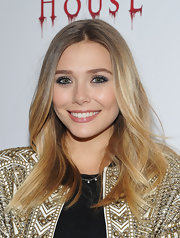 Elizabeth Olsen attended the premiere of 'Silent House' wearing her hair long and casually tousled.