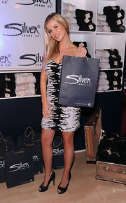 Joanna Krupa teamed her black-and-white cocktail dress with black satin peep-toes.