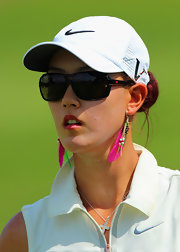Michelle Wie's neon-pink feathered earrings were a colorful and fun finish to her sporty get-up.
