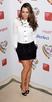Michelle Heaton's black mini skirt with two rows of buttons added a playful touch to the star's evening look.