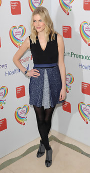 Donna Air kept her look pretty casual with this black dress with a blue, pleated tweed skirt.