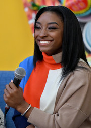 Simone Biles accessorized with a simple silver bracelet at the Lower Eastside Girls Club event.
