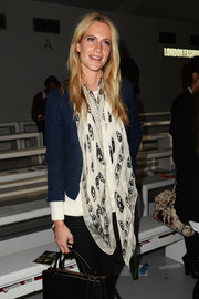 Poppy Delevingne dressed up her casual ensemble with a black-and-white print scarf for the Simone Rocha fashion show.