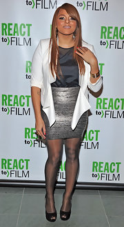 Marsha Ambrosius dazzled in a silver mini skirt and white jacket at the 'Sing Your Song' screening.