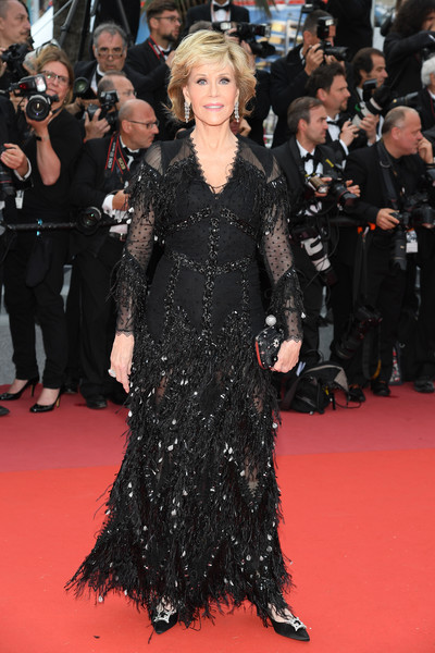 Jane Fonda glammed up in a feathered black gown by Givenchy Couture for the Cannes Film Festival screening of 'Sink or Swim.'