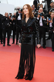 Isabelle Huppert rocked a menswear-meets-flapper look with this sequined and fringed tuxedo dress by Saint Laurent at the Cannes Film Festival screening of 'Sink or Swim.'