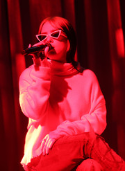Billie Eilish looked cool wearing these angular cateye sunnies at the 2020 Artist Showcase.