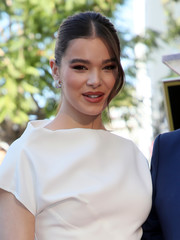 Hailee Steinfeld injected some sparkle with a pair of broad diamond hoops.