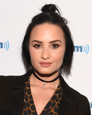 Demi Lovato looked funky with her half-up knot while attending SiriusXM Hits 1's Morning Mash Up Broadcast.