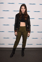 Hailee Steinfeld attended SiriusXM Hits 1's Morning Mash Up Broadcast wearing a black varsity jacket with leather sleeves.