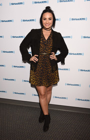 Demi Lovato finished off her look with a pair of black lace-up booties.