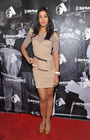 Janina Gavankar stepped onto the red carpet in a nude cocktail dress with strong shoulders and a zippered peplum for the Sirius Studios event.