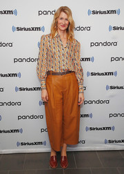 A pair of brown croc-embossed loafers completed Laura Dern's attire.