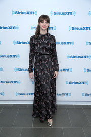 Felicity Jones went conservative in a long-sleeve print top by Valentino for her visit to SiriusXM's Town Hall.
