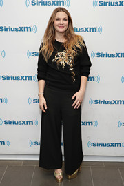 Drew Barrymore visited SiriusXM wearing a comfy yet chic embellished sweater.