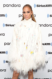 Jennifer Lopez made a glamorous entrance in a beaded and feathered coat by Valentino at SiriusXM's Town Hall.