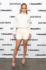Jennifer Lopez looked demure up top in a long-sleeve white pussybow blouse by Valentino while visiting SiriusXM Town Hall.