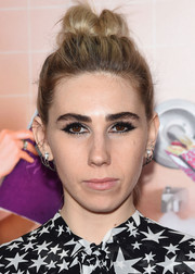 Zosia Mamet pulled her hair up into a messy top knot for the New York premiere of 'Sisters.'