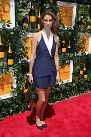 Lauren Remington Platt looked totally chic in a navy halter dress that featured white lapels and belted waist.