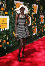 Alek Wek looked totally playful in this black-and-white striped A-line.